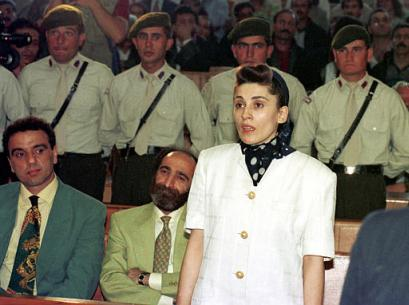 Former Kurdish deputy Leyla Zana, handcuffed gets ready to enter a van after her retrial at a State security court in Ankara, Turkey, Friday, March 28, 2003. Zana is being retried together with three other Kurdish politicians. Zana was originally sentenced to 15 years in prison for collaborating with an outlawed Kurdish group fighting for autonomy in Turkey's southeast. (AP Photo/Nuri Kaynar, Anatolia )
